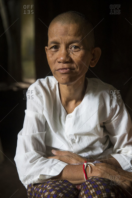 Siem Reap, Angkor, Temple Tha Prom, a woman prays for you and then ties a ribbon around your hand