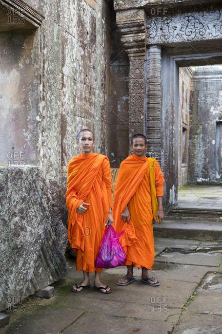 two monks in the temple Preah Vihear, a temple on a mountain plateau, formerly Thai territory, now belongs to Cambodia, the temple is guarded by military, former war zone