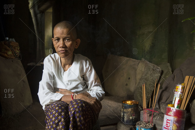 October 10, 2017: Siem Reap, Angkor, Temple Tha Prom, a woman prays for you and then ties a ribbon around your hand