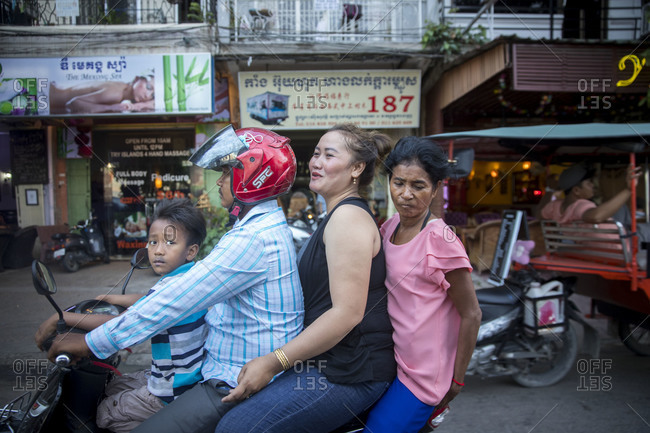 October 6, 2017: Cambodia, Phnom Penh, street scene, a family on a moped