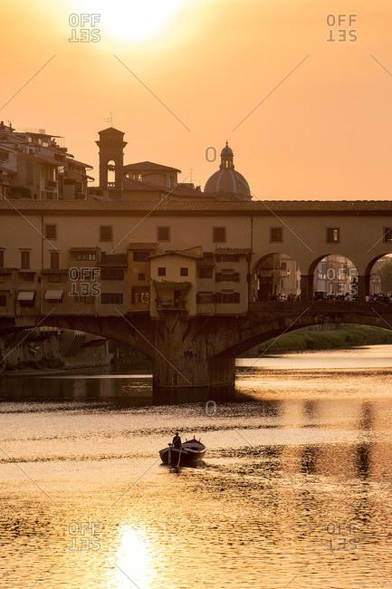 Florence, Ponte Vecchio, boat, sunset