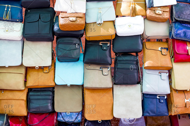 June 6, 2017: Sale of leather goods, weekly market, Alcudia, north coast of the island of Mallorca, Mediterranean Sea, Spain, Southern Europe