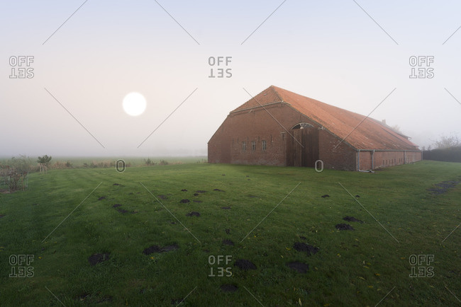 Germany, Lower Saxony, East Frisia, farm in the morning light,