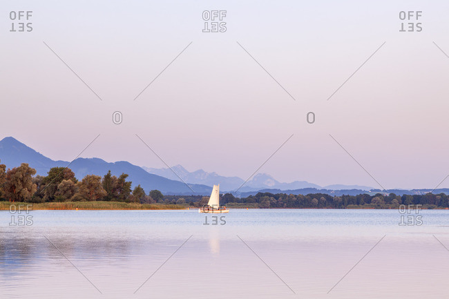 Sailboat on the Chiemsee in front of Chiemgau Alps, Ubersee, Chiemgau, Upper Bavaria, Bavaria, Southern Germany, Germany, Europe
