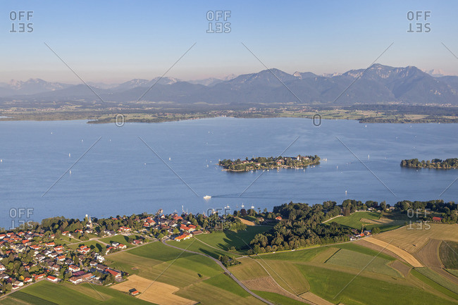 Flight over the Chiemsee with a view of Gstadt behind it the Fraueninsel and Chiemgau Alps, Chiemgau, Upper Bavaria, Bavaria, southern Germany, Germany, Europe
