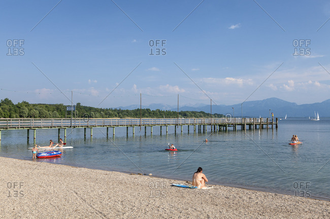 June 12, 2015: Beach and steamers of Seebruck am Chiemsee, Chiemgau, Upper Bavaria, Bavaria, southern Germany, Germany, Europe