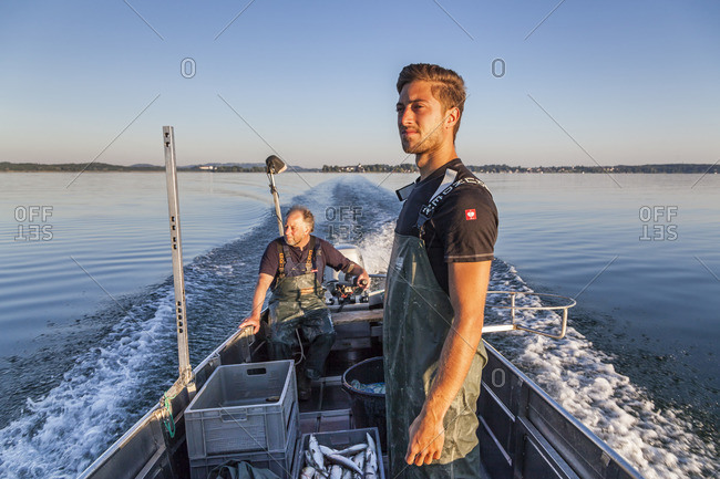 July 1, 2015: Fishermen Thomas and Florian Lex from the Fraueninsel when driving over the Chiemsee, Frauenchiemsee, Chiemgau, Upper Bavaria, Bavaria, southern Germany, Germany, Europe