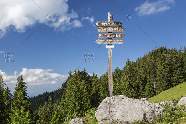 June 24, 2015: Signpost at the Piesenhauser alp to the Kampenwand and Hochplatte in the Chiemgau Alps, Marquartstein, Chiemgau, Upper Bavaria, Southern Germany, Germany, Europe