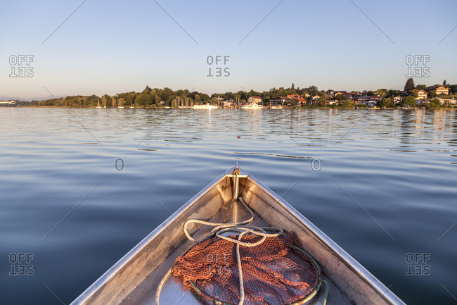 Fishing boat on Lake Chiemsee with view of Gstadt, Frauenchiemsee, Chiemgau, Upper Bavaria, Bavaria, Southern Germany, Germany, Europe