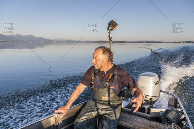July 1, 2015: Fisher Thomas Lex from Fraueninsel on a cruise across Chiemsee, Frauenchiemsee, Chiemgau, Upper Bavaria, Bavaria, Southern Germany, Germany, Europe