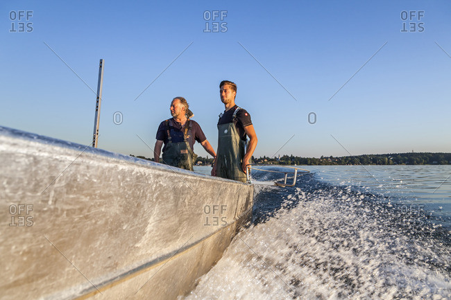 July 1, 2015: Fishermen Thomas and Florian Lex from Fraueninsel on a trip across Chiemsee, Frauenchiemsee, Chiemgau, Upper Bavaria, Bavaria, Southern Germany, Germany, Europe