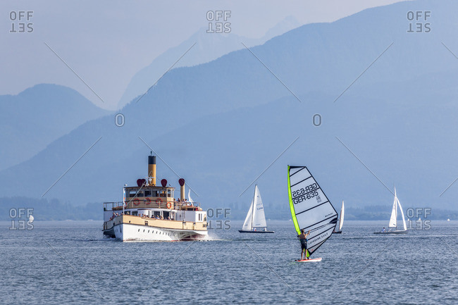 June 12, 2015: Chiemsee with sailboats and paddle steamer Ludwig Fessler, Seebruck am Chiemsee, Chiemgau, Upper Bavaria, Bavaria, southern Germany, Germany, Europe