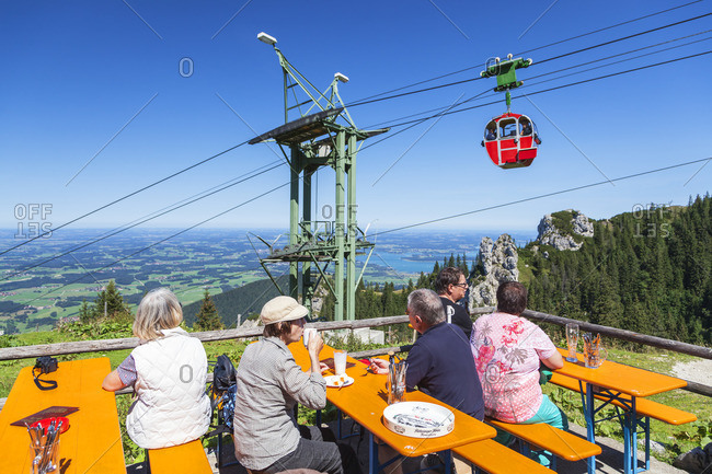 August 26, 2015: Moslarnalm below the Kampenwand behind it the Kampenwandbahn, Aschau, Chiemgau Alps, Chiemgau, Upper Bavaria, Bavaria, southern Germany, Germany, Europe