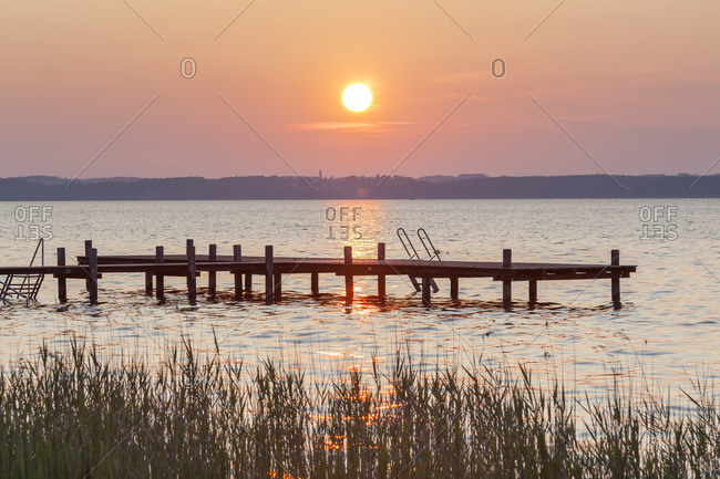 Jetty at sunrise at Lake Chiemsee in Gstadt, Chiemgau, Upper Bavaria, Bavaria, southern Germany, Germany, Europe