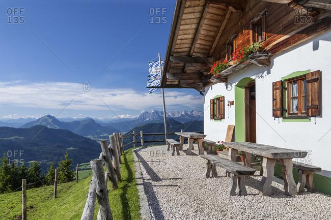 June 25, 2015: Piesenhauser alp in the Chiemgau Alps behind it Wilder Kaiser Mountains, Marquartstein, Chiemgau, Upper Bavaria, Southern Germany, Germany, Europe