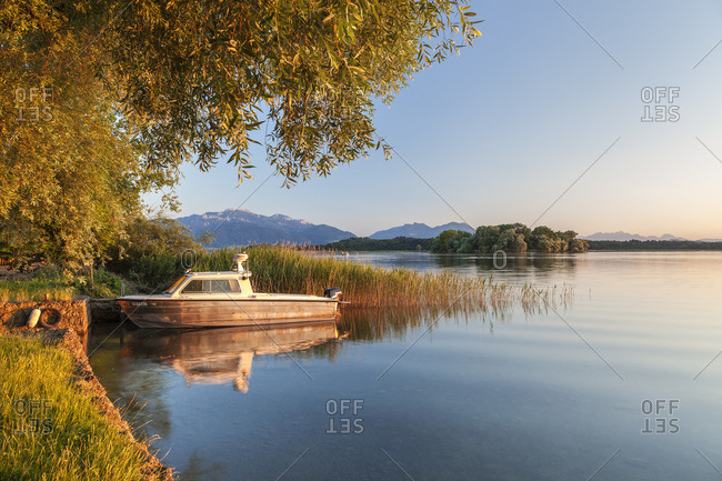 June 30, 2015: Boat on the Chiemsee in front of Chiemgau Alps with Kampenwand, Fraueninsel, Frauenchiemsee, Chiemsee, Chiemgau, Upper Bavaria, Bavaria, southern Germany, Germany, Europe