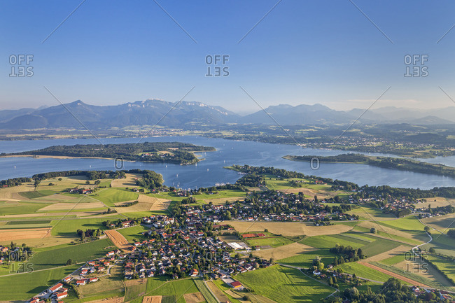 Flight over the Chiemsee with views of Breitbrunn behind the Herreninsel and Chiemgau Alps, Chiemgau, Upper Bavaria, Bavaria, southern Germany, Germany, Europe