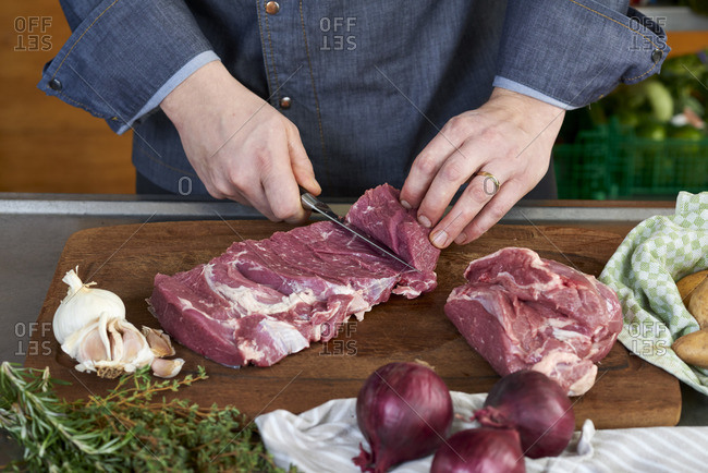 Photo series, step-by-step preparation of a leg of lamb filled with herbs and Provencal vegetables by using a food processor