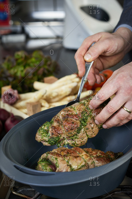 Photo series, step-by-step preparation of a leg of lamb filled with herbs and Provençal vegetables by using a food processor , placing the leg of lamb in the Varoma ®
