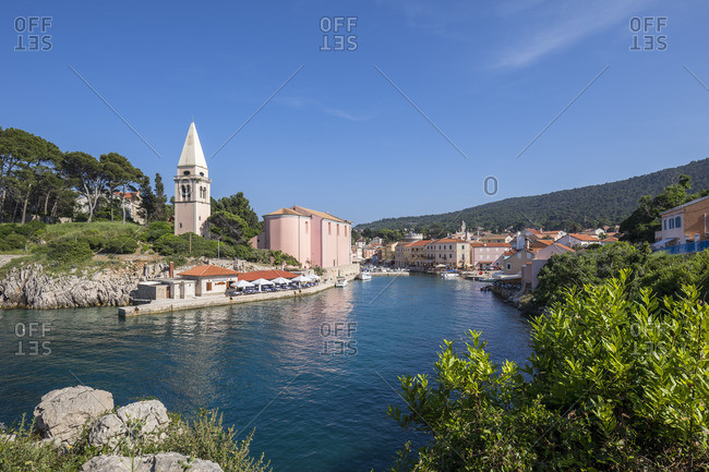 May 26, 2018: Veli Losinj harbor entrance with baroque Parish Church of Saint Anthony, Losinj Island, Kvarner Bay, Croatia