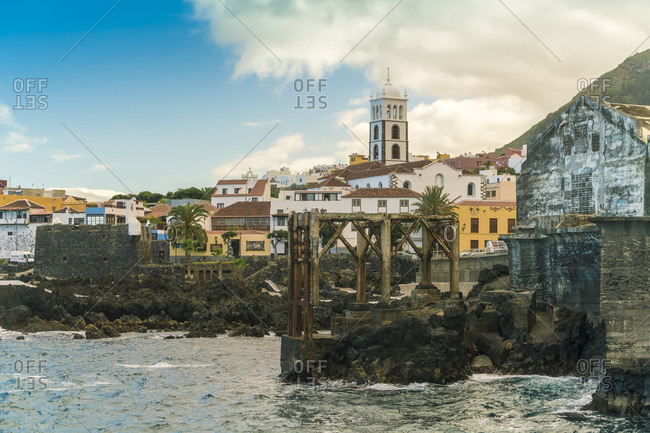 Garachico, CN, Spain - December 16, 2016: Garachico old town seafront with the old church in the foreground