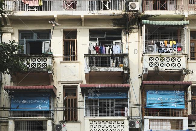Yangon, Yangon Region, Myanmar (Burma) - October 30, 2019: Local building with colonial architecture in Yangon, Myanmar