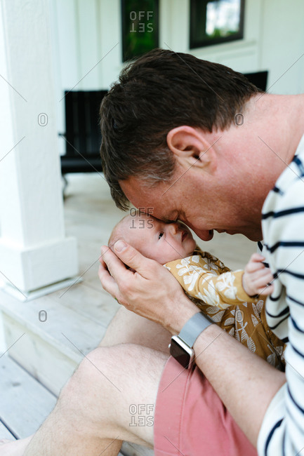 Cropped portrait of a father cuddling with his newborn baby daughter