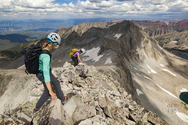 Women descend ridge on Capitol Peak, Elk Mountains, Colorado