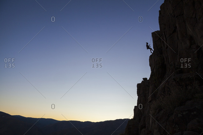 Rock climber hangs on rope at North Table Mountain, Golden, Colorado