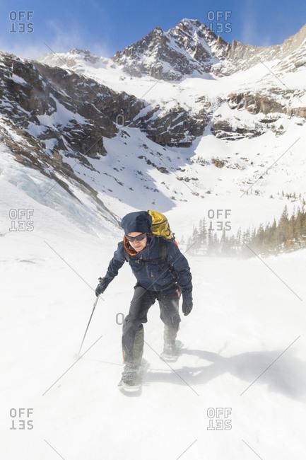 Hiker battles wind above Black Lake, Rocky Mountain National Park