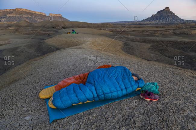 People camp in Factory Butte badlands, Utah