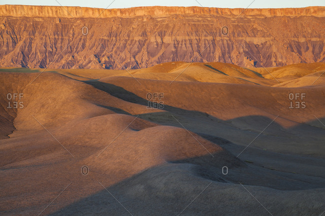 North Caineville Mesa and badlands at sunrise, Upper Blue Hills, Utah