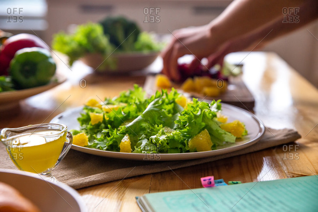 Caesar salad with copy space on a wooden table on kitchen