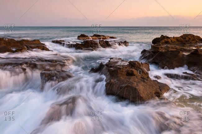 Sunset seascape taken on St. Andrew beach near Ierapetra, Crete.