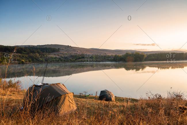 Fishing adventures, carp fishing in sunrise.