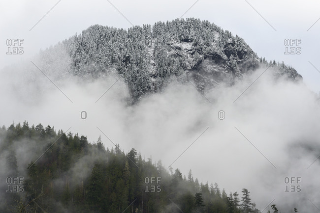 Snow Covered Mountain With Fog Rolling Below