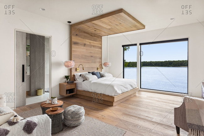 Bedroom in new luxury home with hardwood floors and gorgeous view