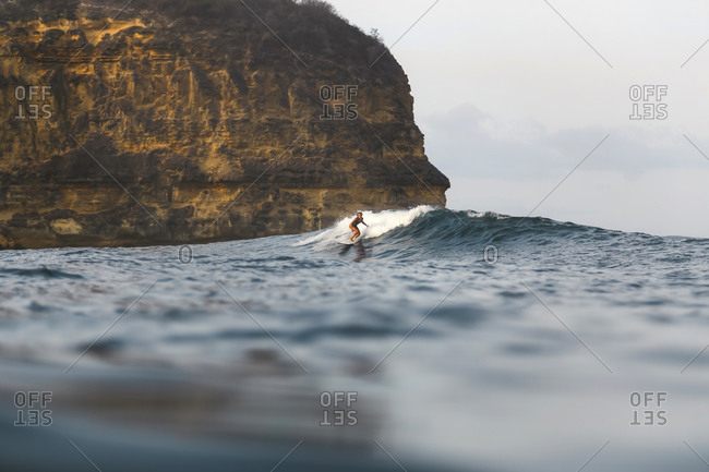 Young woman surfing in Indian Ocean