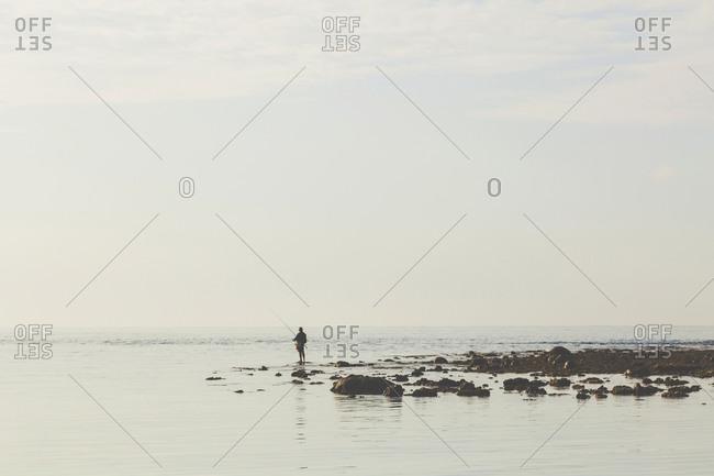 Fisherman at Indian Ocean coastline