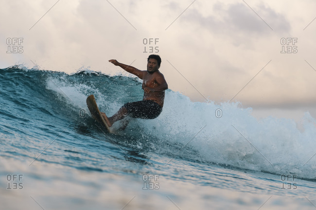 Surfer on a wave at day time