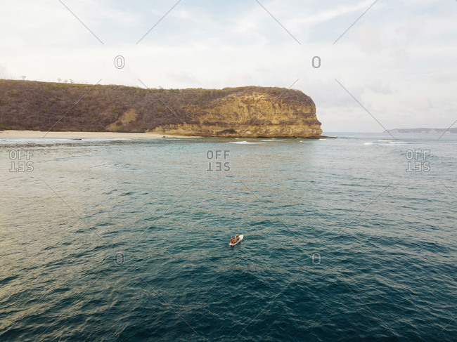 Aerial view of surfer in Indian Ocean near Lombok island
