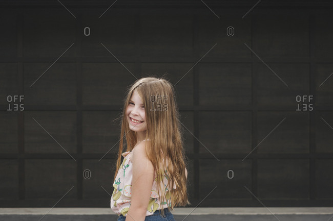 Portrait of a pretty young girl smiling at the camera