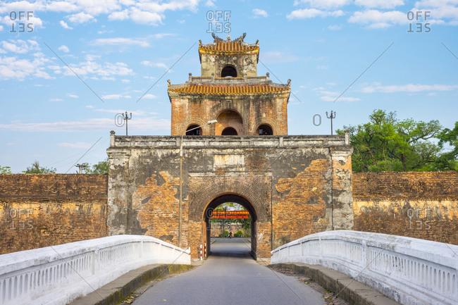 Hue, Thua Thien Hue, Vietnam - February 23, 2015: Bridge and gate tower through ancient city walls of Imperial City, Hue