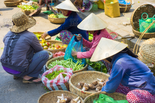 Hoi An, Quang Nam Province, Vietnam - February 26, 2015: Women selling vegetables at Hoi An market