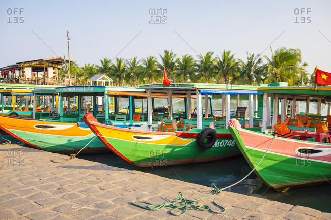 Hoi An, Quang Nam Province, Vietnam - March 2, 2015: Boats on the Thu Bon River, Hoi An, Vietnam