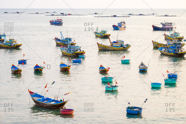 Phan Thiet, Bahn Thuan Province, Vietnam - March 18, 2015: Fishing boats in harbor at Mui Ne, Vietnam