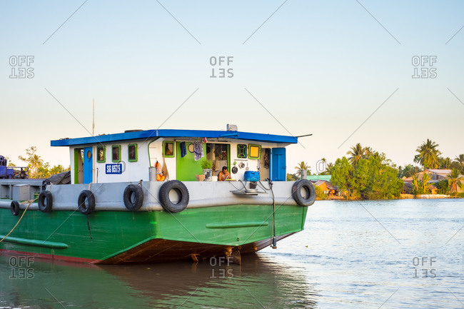 Can Tho, Vietnam - March 25, 2015: Boat on a branch of the Mekong River near Can Tho, Vietnam