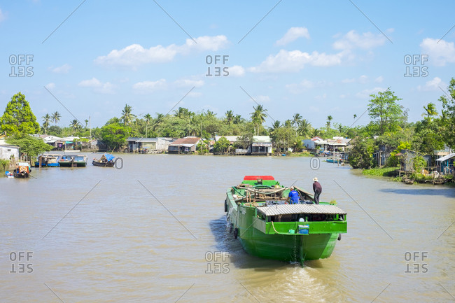 Can Tho, Vietnam - March 26, 2015: A boat on a branch of the Mekong River, Can Tho, Vietnam