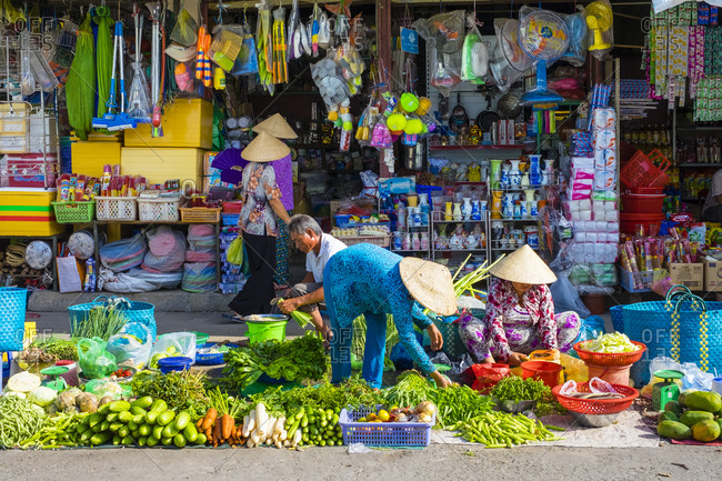 Can Tho, Vietnam - March 27, 2015: Vietnamese women selling vegetables, An Binh Market, Can Tho, Vietnam