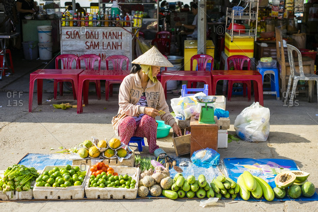 Can Tho, Vietnam - March 27, 2015: Vietnamese woman selling vegetables, An Binh Market, Can Tho, Vietnam